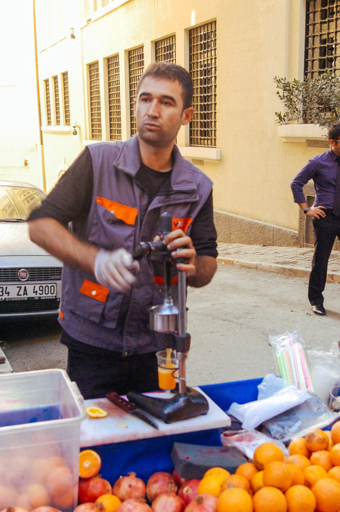 Man selling fruit juices in the streets of Istanbul