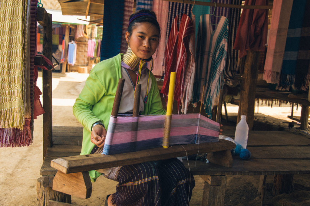 A young girl from the hilltribes is weaving.
