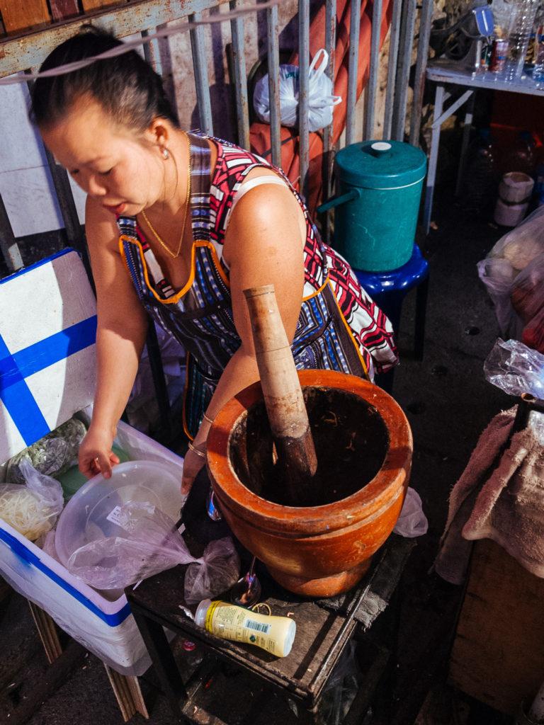 Women preparing Pad Thai in the streets of Pai