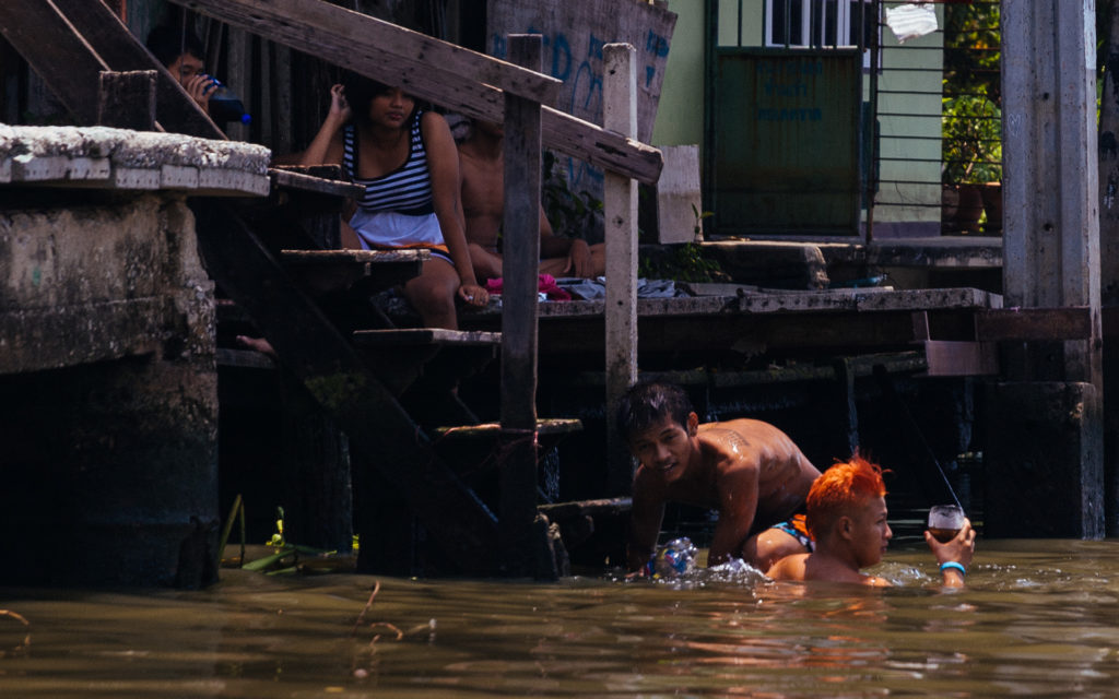 Taking a bath in the klongs of Bangkok