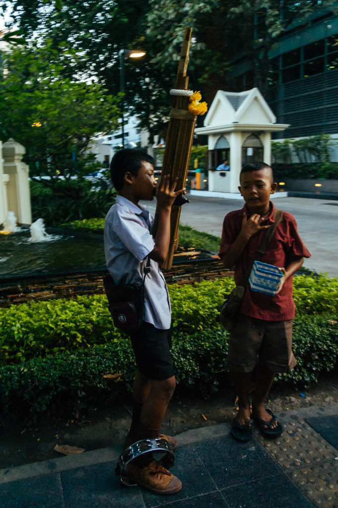Kids busking in the streets of Bangkok