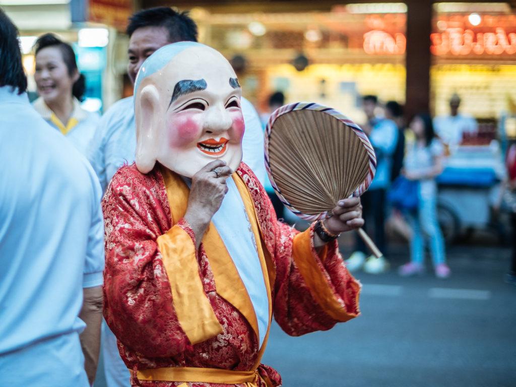 A man wearing a mask, Vegetarian Food Festival, Bangkok
