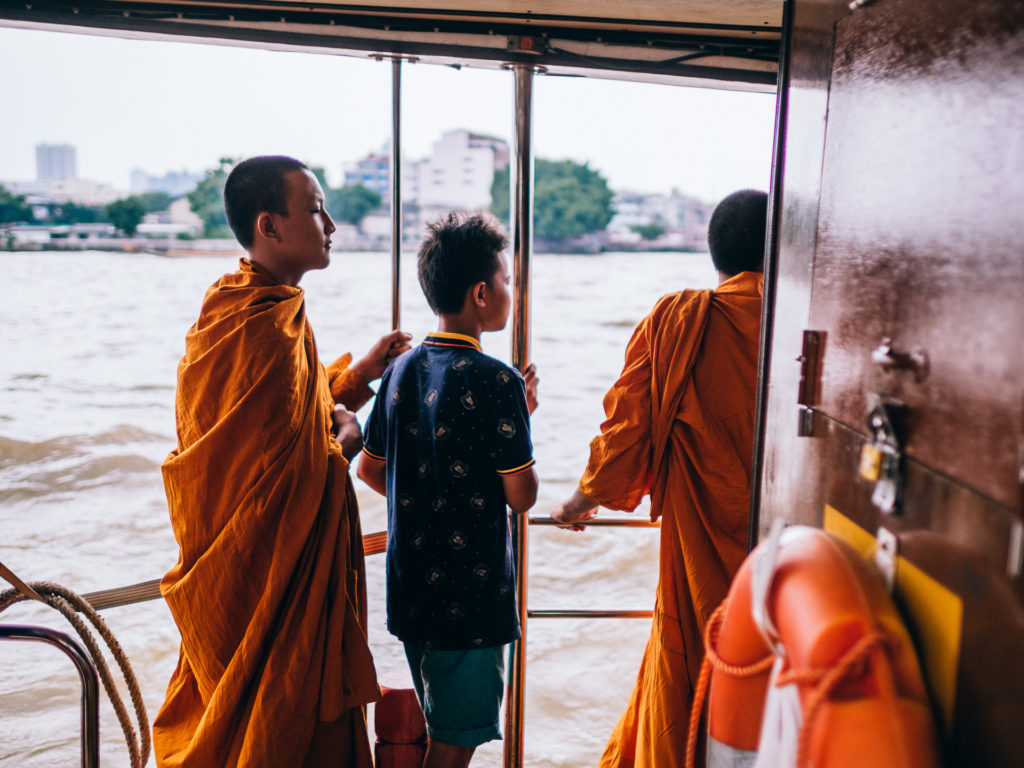 Young monks crossing the river on a boat to Wat Arun, Bangkok
