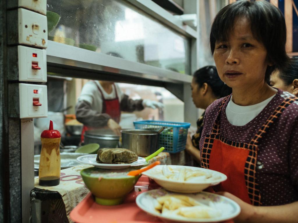 Waitress in a restaurant, Hong Kong
