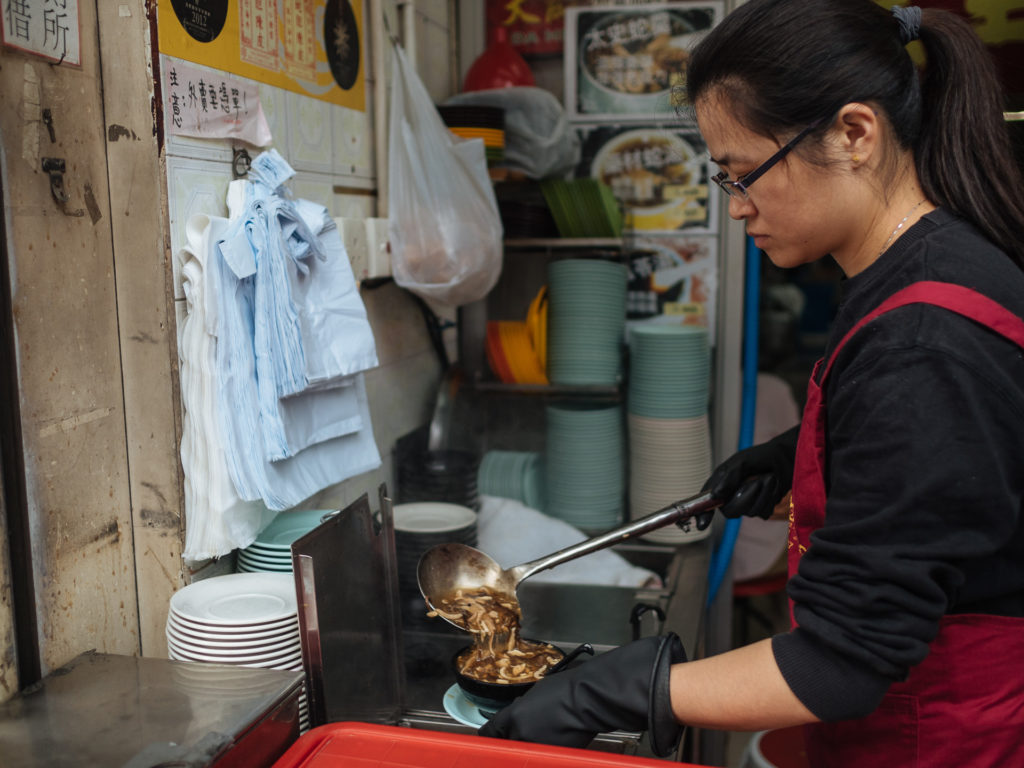 Woman serving snake soup, Hong Kong
