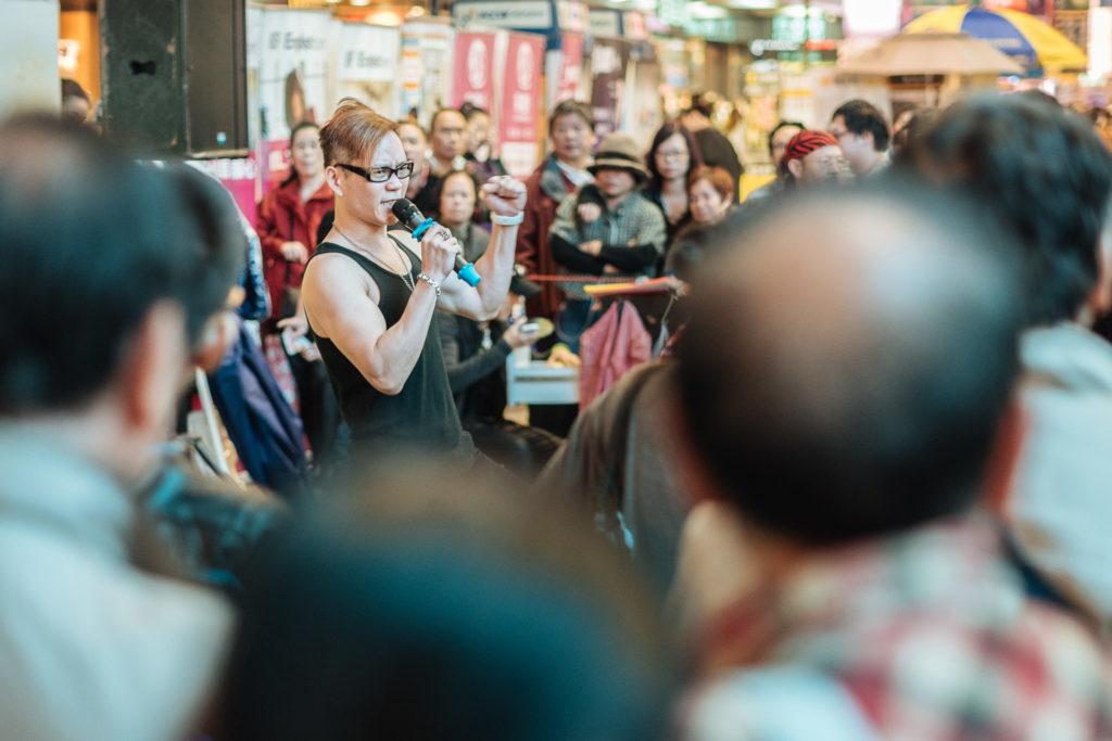 Street singer in Sai Yueng Choi street, Hong Kong